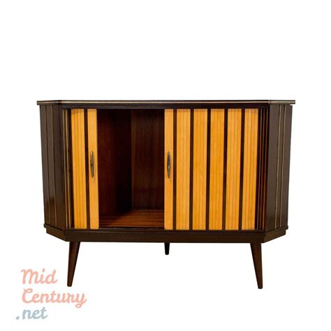 mid century corner corner sideboard with rolling shutters mid century