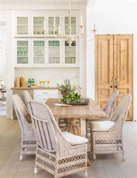 kitchen table with wicker chairs dining nook in butler pantry and mullion cabinets