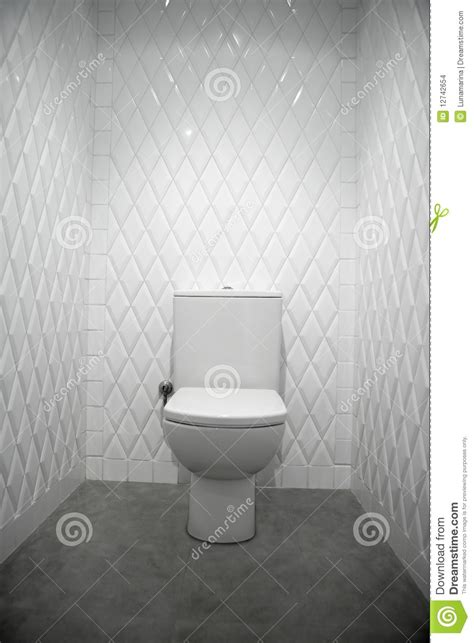 Toilet In A White Room Diamond Shape Tiles Stock Images   Image: 12742654
