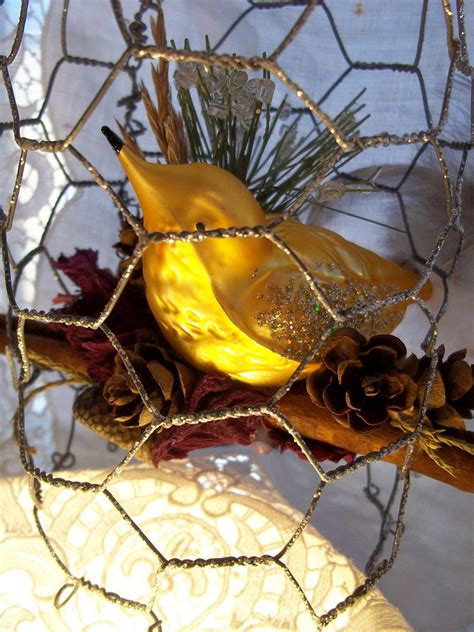 christmas ornament chicken wire birdcage with golden glass