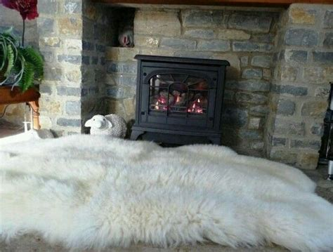 sheepskin rug  front   fireplace grosser