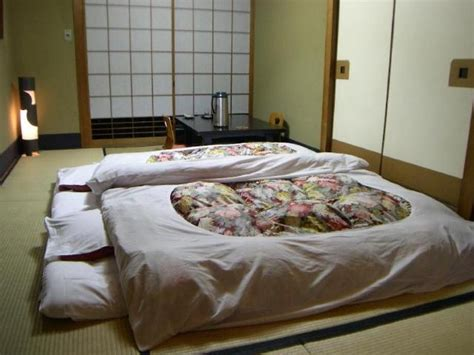 japanese style futon a tatami room with the futons laid out for sleeping in