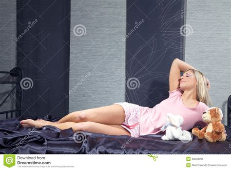 animal in bed woman lying in bed with stuffed animal stock photo image 40598395