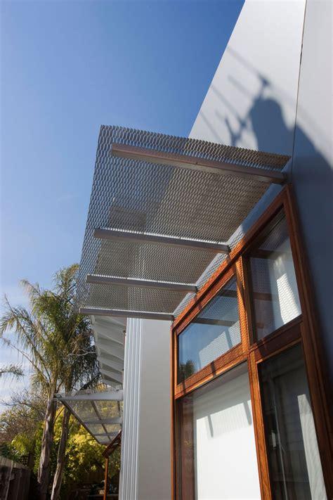 wood awning design iron pergola above wood framed glass windows orrong road