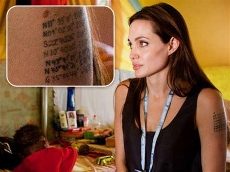 tattoos angelina jolie koordinaten siebte linie mit koordinaten auf dem arm wirbel um