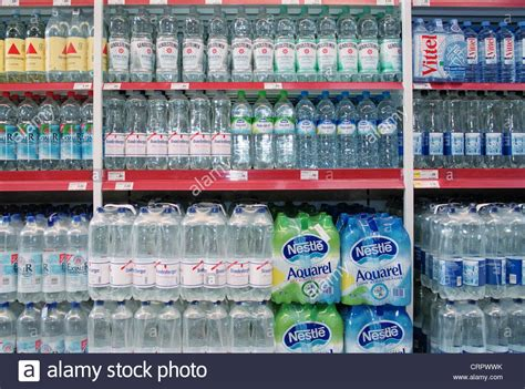 Shelf Of Water by Supermarket Shelves Of Mineral Water Pet Bottles