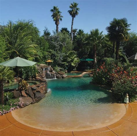 beach backyard beach entry resort style pool in backyard outside and