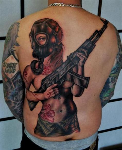 zombie tattoo gun women back gun gas mask tattoo by benjamin laukis