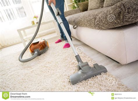 Vacuum Living Room In Cleaning Carpet In Living Room Stock Photo Image 68231314