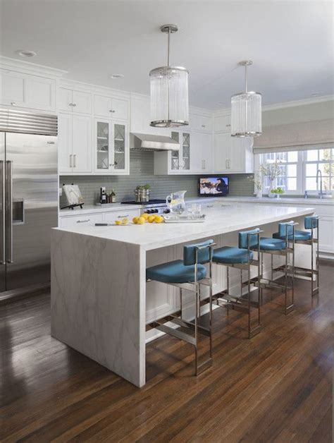 Kitchen Island Marble Waterfall Edge White Marble Looking Granite Shaker Cabinets Wood Floors Medium