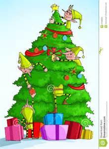 Elf decorating christmas tree royalty free stock image