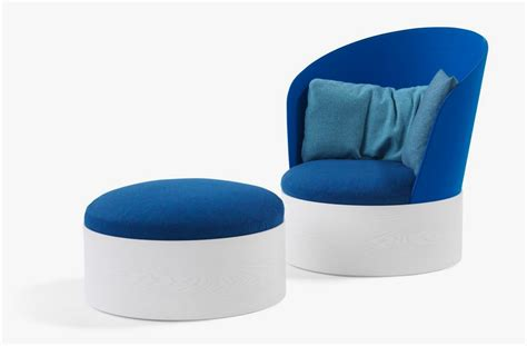 front view of blue stool and stylish and cozy easy chair in round shape home building
