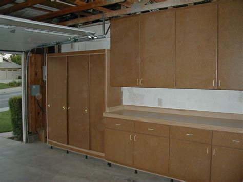 Kitchen Cabinets For Garage by Garage Cabinets Garage Cabinets Sliding Doors