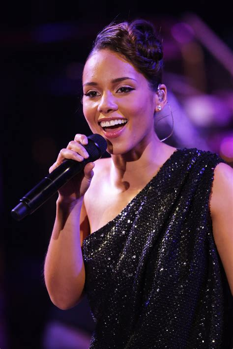 alicia keys tongue alicia keys in keep a child alive black ball inside