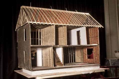 realistic doll house photographing a destroyed home diorama using dollhouse supplies