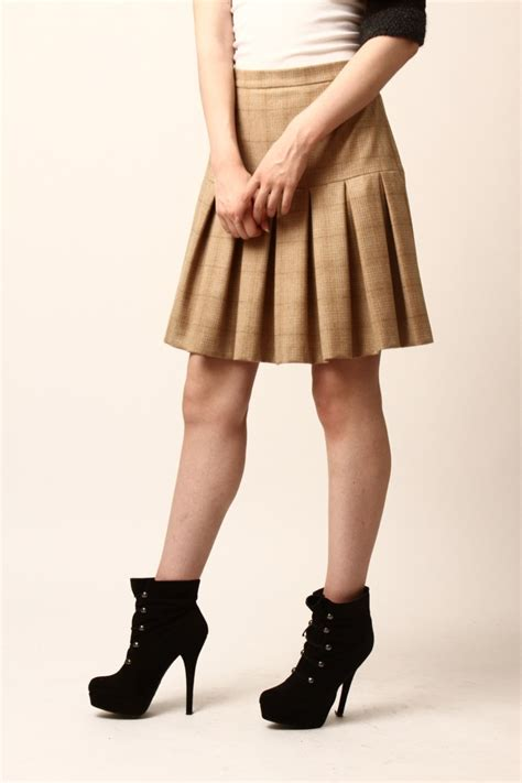 castillo knee length pleated skirt from
