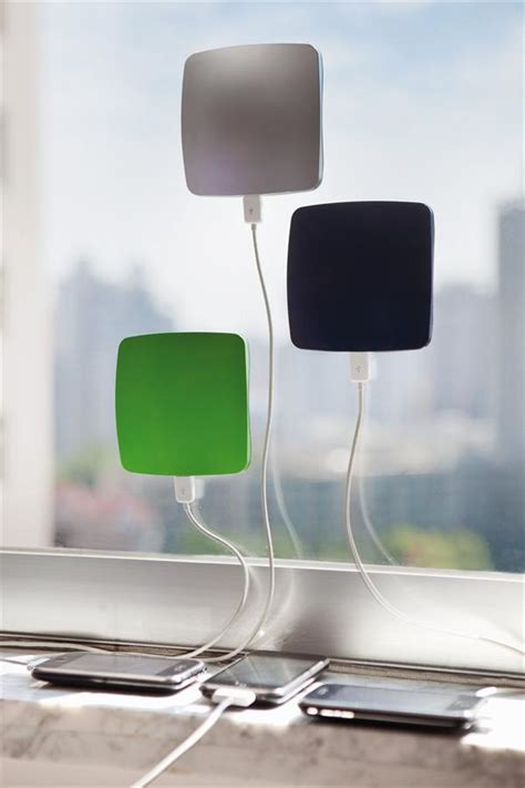 A Solar Powered Phone Charger That Sticks To Any Window