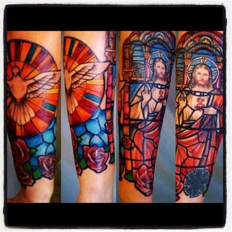 stained glass tattoo great work by beau jones inkedmagazine stainedglass