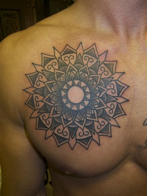 tattoo on chest meaning chest circle pattern tattoo for men cool man tattoos