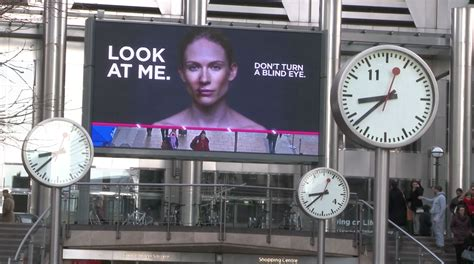 domestic violence billboard dares people not to look away interactive billboards address domestic violence the