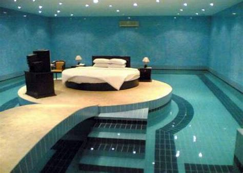 coolest bedroom it s a bed surrounded by water picture