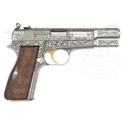 Sadum Semi 4 one of a captured browning renaissance high power semi auto pistol as liberated from saddam
