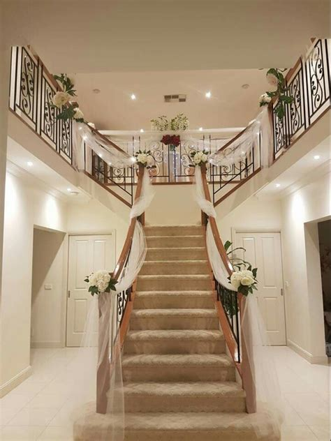 how to decorate banister simply and elegantly for christmas wedding preparation staircase decor stairs decor wedding preparation