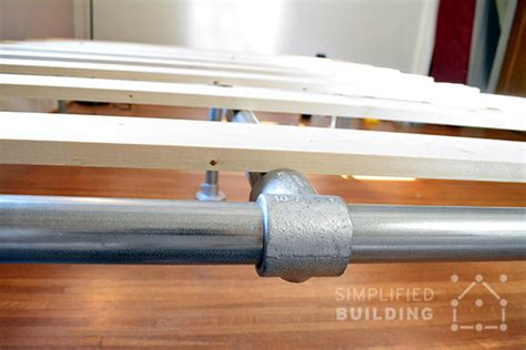 diy pipe bed frame how to build a bed frame the easy way simplified building