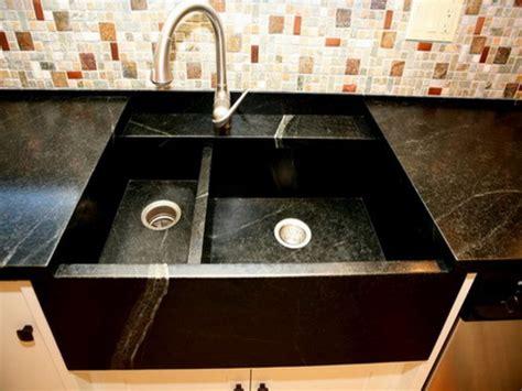 black marble square undermount kitchen sink under mosaic
