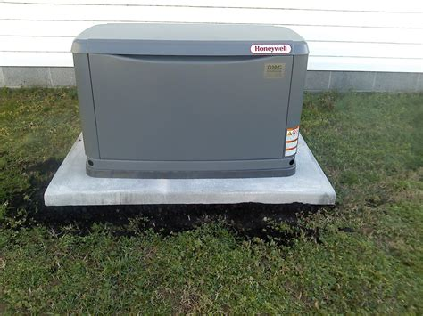 house generators generac 20 kilowatt whole house generator installed on a preformed concrete pad by