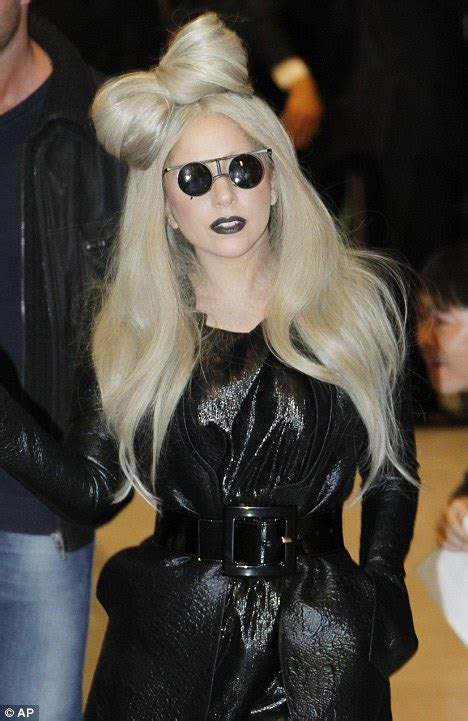 arriving in style lady gaga chose a vintage cadillac to take her to lady gaga revisits the bow in her hair has she finally