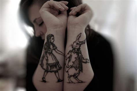 alice in wonderland wrist tattoos and tattoologist