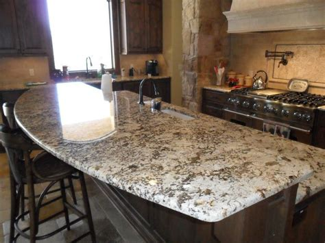 golden cabinets north hollywood river white granite with dark cabinets river white