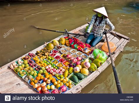 floating boat market vietnam north floating market woman selling fruit
