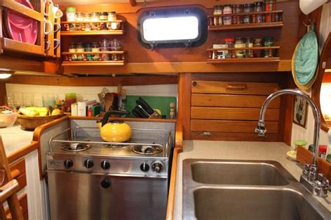 small boat kitchen ideas cooking afloat cupboard boating and pouches