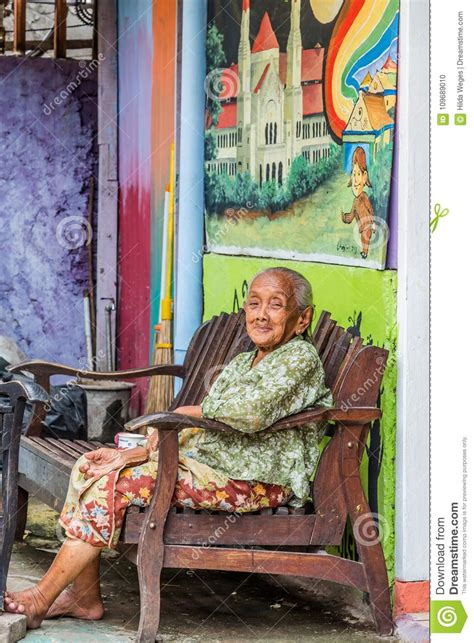 smiling  woman  window editorial photo