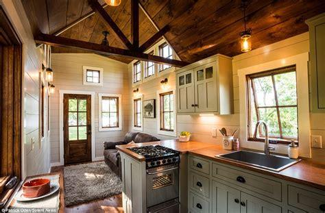 timbercrafts tiny homes house hits  market