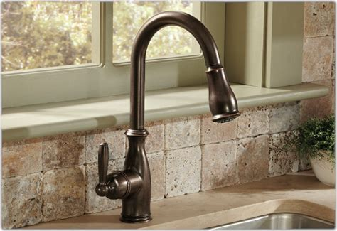 moen brantford kitchen faucet rubbed bronze moen 7185orb brantford one handle high arc pull kitchen faucet rubbed bronze touch