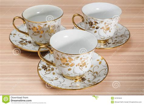 fancy cups images fancy cup saucer isolated on a table stock images