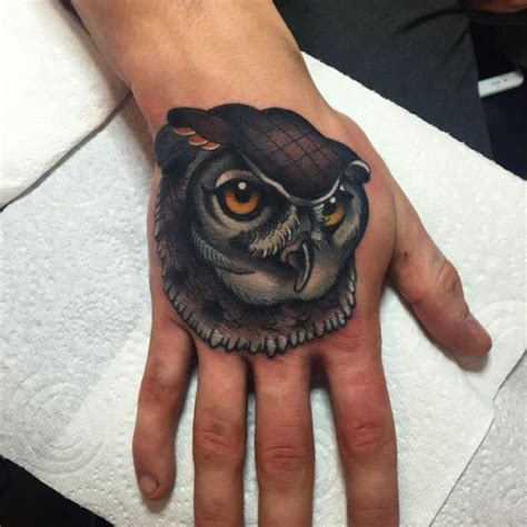 owl hand tattoo owl pictures to pin on tattooskid