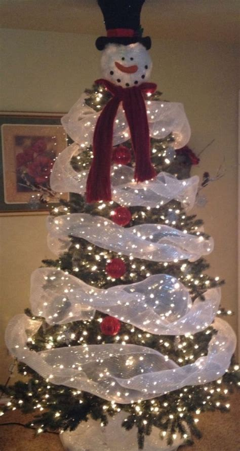 christmas tree decorated with snowmen make a snowman out of a tree craft projects for every fan
