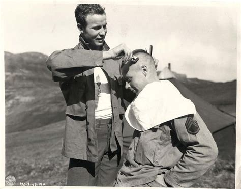 ww2 american military haircut 1944 u s soldier giving comrade a mohawk haircut in