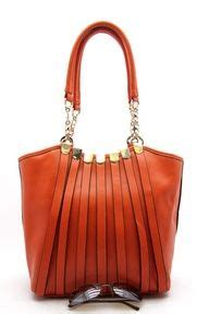 Philodendron Orange By Fab Outlet and it s in my favorite color bag