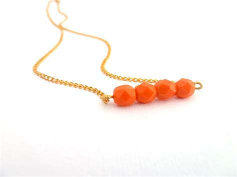 orange bead necklace orange beaded bar necklace gold plated chain glass