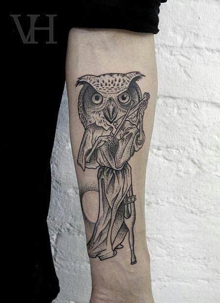 black tattoo ink animal bones owl tattoos on forearm