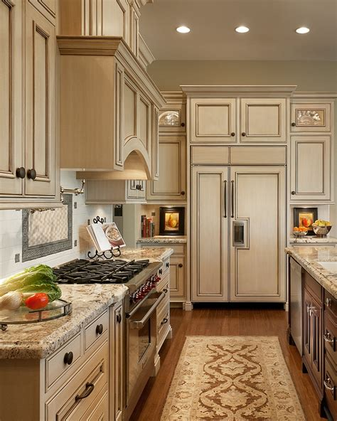 antique ivory kitchen cabinets with black brown granite counter tops and coordinating island
