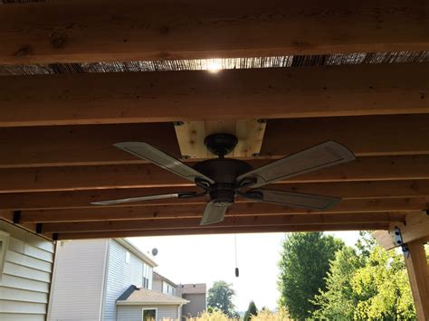custom electrical install of ceiling fan for pergola all
