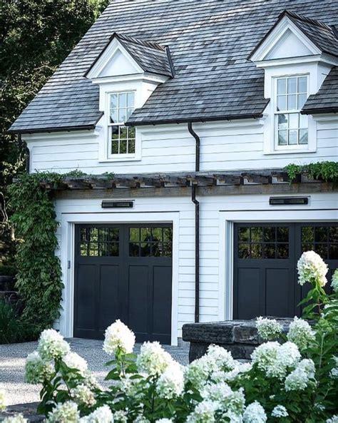 gorgeous white modern farmhouse  black garage doors