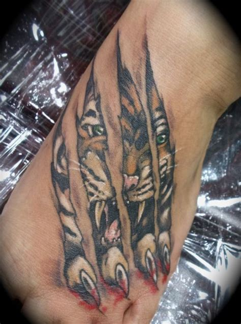 tiger scratch tattoo designs tiger ripping through skin tattoos