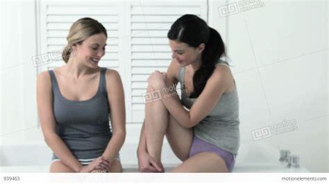 sitting bathtub two young woman sitting on edge of bathtub stock video
